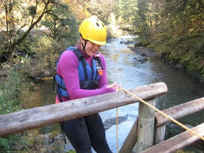 Hydrophiles Club member rappelling down to a stream