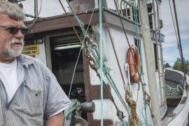 Amanda Gladics, Oregon Sea Grant's Extension fisheries management specialist talks with shrimper David Vandecoevering