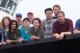 Oceanus coring cruise crew, including REU students Angelica Robles (fourth from left), Iris Romo (eighth from left, green shirt), and Alyson Churchill (10th from left, blue shirt).
