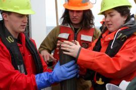 Students doing coring work aboard R/V Oceanus