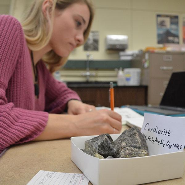 student studying in the rock lab