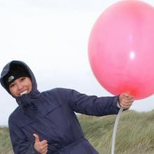 student launching weather balloon
